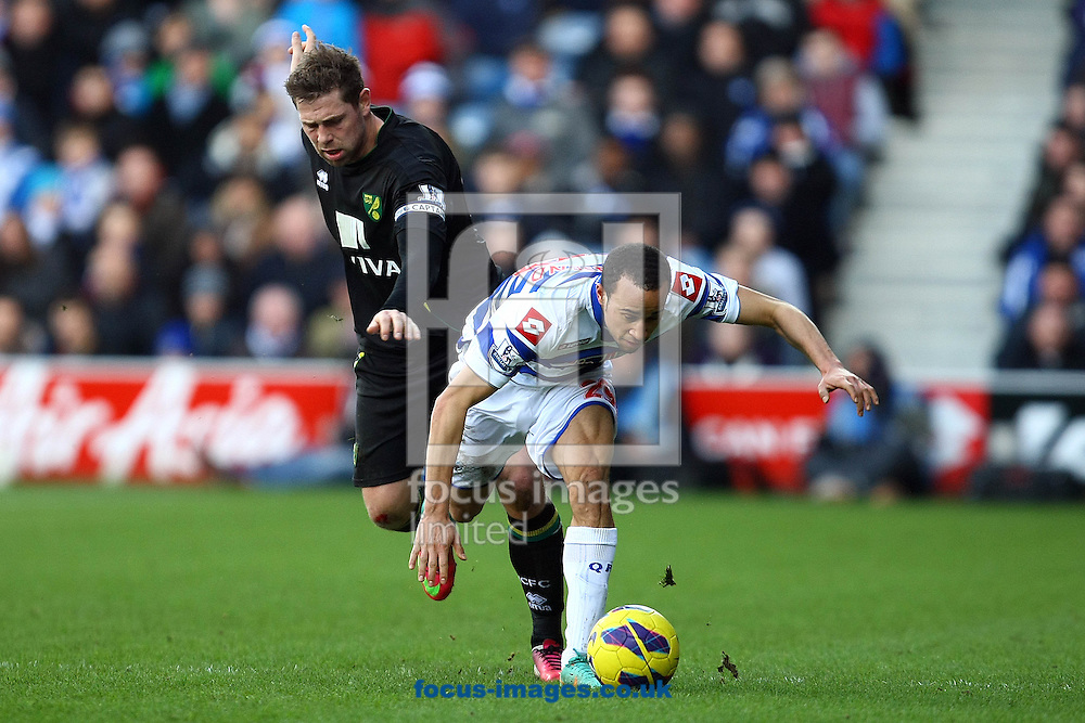 Picture by Paul Chesterton/Focus Images Ltd +44 7904 640267.02/02/2013.Grant Holt of Norwich and Andros Townsend of QPR in action during the Barclays Premier League match at the Loftus Road Stadium, London.