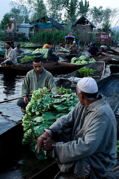 Travel photos of the sceneries in and around Kashmir, Dal Lake, and its Vegetable Boat Market. .*Pre-season Jeep road trip from Delhi to Amritsar, Srinagar, Kargil, Lamayuru, Leh, Khardung La, Tso Moriri and back to Delhi in May 2010. Photo by Suzanne Lee