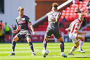 Leeds United midfielder Kalvin Phillips (23) and Leeds United forward Patrick Bamford (9) in action during the EFL Sky Bet Championship match between Stoke City and Leeds United at the Bet365 Stadium, Stoke-on-Trent, England on 24 August 2019.