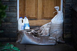 © Licensed to London News Pictures. 29/12/2015. York, UK. Milk left on the doorstep of a previously flooded property on Huntington Road in York town centre on December 29, 2015. Water levels in the area surrounding the Foss river have now dropped off.. Photo credit: Ben Cawthra/LNP
