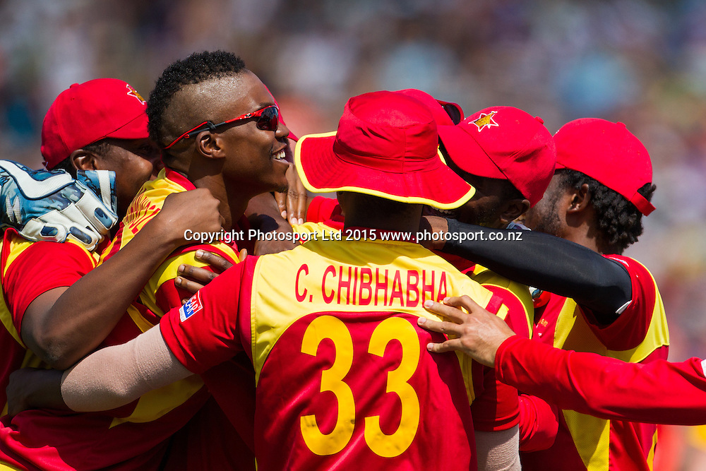 Zimbabwe celebrate the wicket of South African captain AB de Villers during the ICC Cricket World Cup match - South Africa v Zimbabwe at Seddon Park, Hamilton, New Zealand on Sunday 15 February 2015.  Photo:  Bruce Lim / www.photosport.co.nz