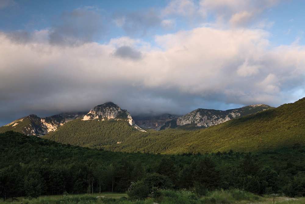 Mali Troglav (main visible mountain) and clouds on Troglav mountain (1913 m), the highest peak of the Dinara mountain range. Seen from Livansko Polje.  May 2009. Bosnia-Herzegovina.<br /> Elio della Ferrera / Wild Wonders of Europe