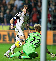 27.10.2013, Liberty Stadion, Swansea, ENG, Premier League, Swansea City vs West Ham United, 09. Runde, im Bild Swansea City's Miguel Perez Cuesta 'Michu' sees his shot saved bt West Ham United's goalkeeper Jussi Jaaskelainen, but he was flagged off-side, // during the English Premier League 09th round match between Swansea City AFC and West Ham United at the Liberty Stadion in Swansea, Great Britain on 2013/10/27. EXPA Pictures © 2013, PhotoCredit: EXPA/ Propagandaphoto/ David Rawcliffe<br /> <br /> *****ATTENTION - OUT of ENG, GBR*****