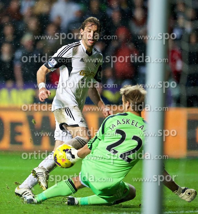 27.10.2013, Liberty Stadion, Swansea, ENG, Premier League, Swansea City vs West Ham United, 09. Runde, im Bild Swansea City's Miguel Perez Cuesta 'Michu' sees his shot saved bt West Ham United's goalkeeper Jussi Jaaskelainen, but he was flagged off-side, // during the English Premier League 09th round match between Swansea City AFC and West Ham United at the Liberty Stadion in Swansea, Great Britain on 2013/10/27. EXPA Pictures &copy; 2013, PhotoCredit: EXPA/ Propagandaphoto/ David Rawcliffe<br /> <br /> *****ATTENTION - OUT of ENG, GBR*****