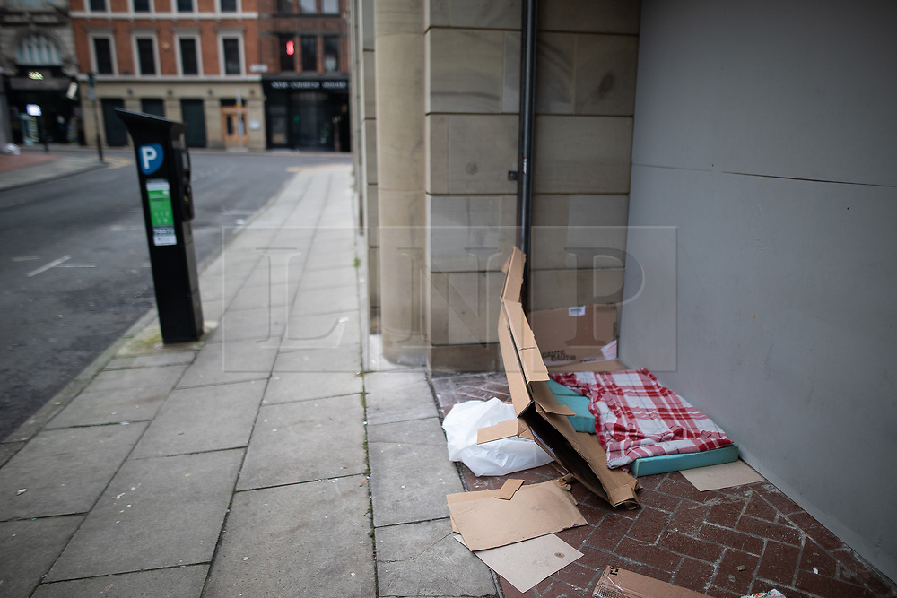 © Licensed to London News Pictures . 25/12/2018 . Manchester , UK . An empty makeshift bed in a boarded up shop window off John Dalton Street . Homeless people sleeping rough on the streets of Manchester City Centre on Christmas Day . Photo credit : Joel Goodman/LNP