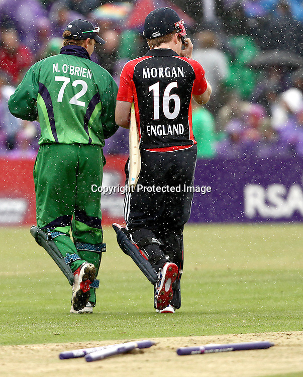RSA Challenge ODI, Clontarf Cricket Club, Dublin, 25/8/2011<br />Ireland vs England<br />Ireland's Niall O'Brien and Eoin Morgan of England in convesation as they leave the field during a rain delay<br />Mandatory Credit &copy;INPHO/James Crombie  *** Local Caption ***