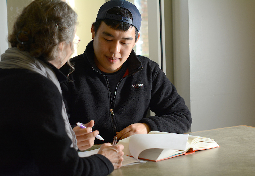 Ohio University student Jihoon Wi receiving help from the Student Writing Center's tutor Kathy Devecka at Alden library.