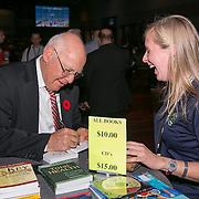 November 11, 2014, Las Vegas, Nevada:<br /> Keynote speaker Peter Burwash signs books for TEAMS registrants during General Session #1 at the Las Vegas Convention Center in Las Vegas, Nevada Tuesday, November 11, 2014.<br /> (Photo by Billie Weiss/TEAMS)