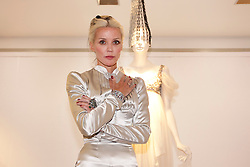 © Licensed to London News Pictures. 21/06/2012. LONDON, UK. Fashion muse Daphne Guinness stands in front of an Alexander McQueen dress (Est: £15,000-20,000) designed for her by the late fashion designer ahead of an auction at Christies South Kensington Auction House in London today (21/0612).  The auction, held in aid of The Isabella Blow Foundation, features 102 lots of shoes, clothes and photographs from Daphne Guinness's private collection and is expected to realise in the region of £100,000 when it takes place on the evening of the 27th of June. Photo credit: Matt Cetti-Roberts/LNP
