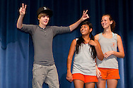 SANFORD, FL -  AUGUST 5  Justin Bieber meets with band camp students at Seminole High School in Sanford, Florida, on August 5, 2010. Bieber was on hand as part of a Best Buy and Grammy Foundation donation to the music program at Seminole High School.(Photo by Matt Stroshane/Getty Images)