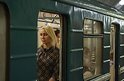 A Russian girl deep in thought as her train pauses at Biblioteca Im Lenina (The Lenin Library) Metro Station , opened in 1935.
