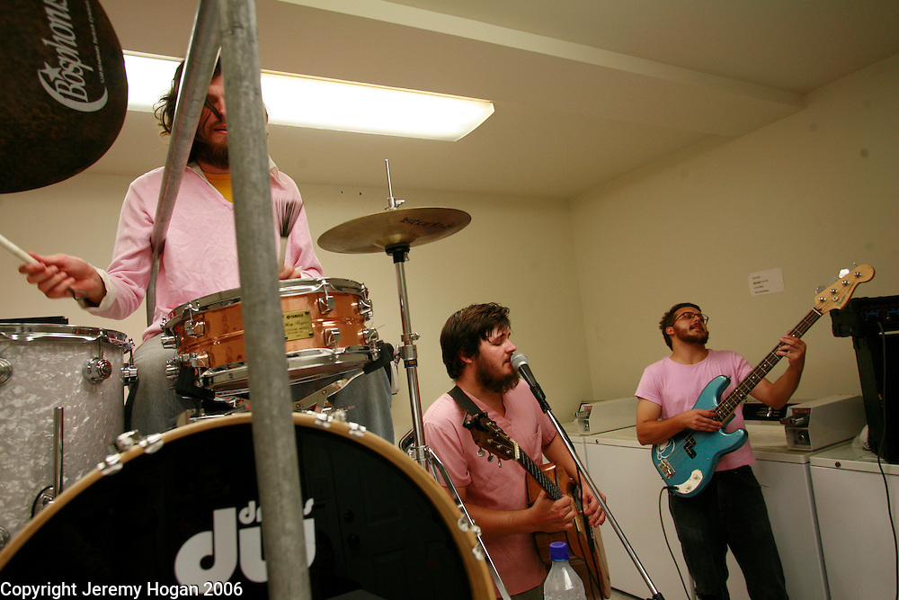Dust From a Thousand Years plays a show in the Laundry Room at Bicycle Apartments. David Pugh, Bass; Ben Rector, keys; Michael Hodges, lead guitar - striped shirt; Matt Wissig, drums and Erik Rassmussen, pink shirt Guitar.