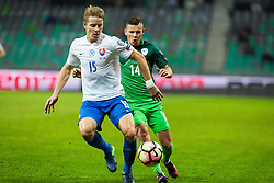 Roman Bezjak of Slovenia and Tomas Hubocan of Slovakia during football match between National teams of Slovenia and Slovakia in Round #2 of FIFA World Cup Russia 2018 qualifications in Group F, on October 8, 2016 in SRC Stozice, Ljubljana, Slovenia. Photo by Ziga Zupan / Sportida