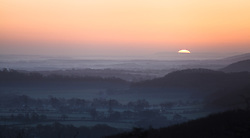 © Licensed to London News Pictures. 05/03/2014. Butser Hill, Hampshire, UK. Sunrise across the South Downs National Park, today 5th February 2014. Photo credit : Rob Arnold/LNP