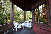 MADISON, WI — SEPTEMBER 2: The Buell House features an angled porch overlooking Lake Mendota below the rounded turret corner of the building.