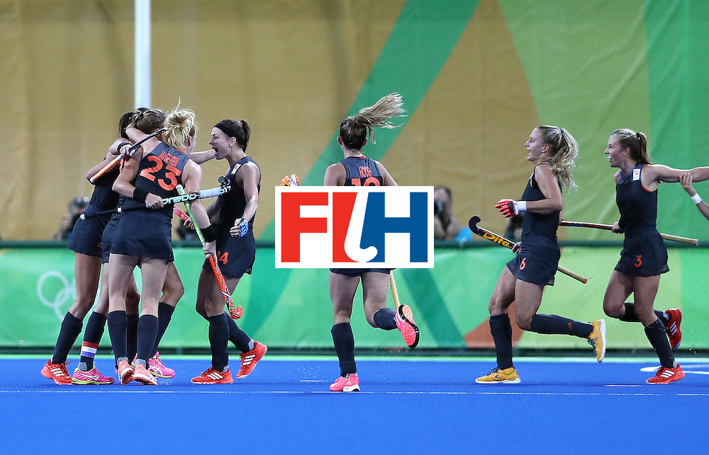 RIO DE JANEIRO, BRAZIL - AUGUST 19:  Netherlands players celebrate the second goal scored by Maartje Paumen during the Women's Gold Medal Match against the Netherlands on Day 14 of the Rio 2016 Olympic Games at the Olympic Hockey Centre on August 19, 2016 in Rio de Janeiro, Brazil.  (Photo by David Rogers/Getty Images)