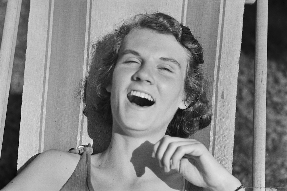 Woman laughing, with glasses, Molln, Austria, 1935