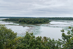 "Greer Island in Lake Worth as seen from Lone Point on the Canyon Ridge Trail, Fort Worth Nature Center, Fort Worth, Texas USA. Greer Island is the home of the famed Lake Worth Monster, or ""Goatman""."