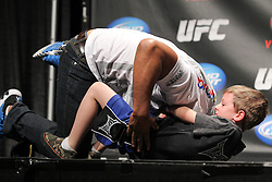October 1, 2011; Washington D.C.; USA; UFC fan Randy Watson chokes out Mark Munoz during the UFC Fight Club Q & A during the UFC on Versus Weigh-In's at the DC Armory.