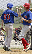 Steve Marshall (20) and Clint Wolf, from Xenia celebrate as Wolf crosses home plate following his home run during a game between the Springfield Indians and the Dayton Rangers of the Miami Valley Adult Baseball League, at Rotary Park in Beavercreek, Sunday, July 15, 2007.  The Rangers won the game 11 - 3.
