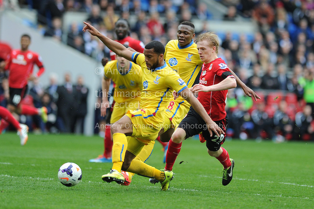 Adrian Mariappa of Crystal Palace holds off Cardiff's Mats Daehli. Barclays Premier league match, Cardiff city v Crystal Palace at the Cardiff city stadium in Cardiff, South Wales on Saturday 5th April 2014.<br /> pic by Andrew Orchard, Andrew Orchard sports photography.
