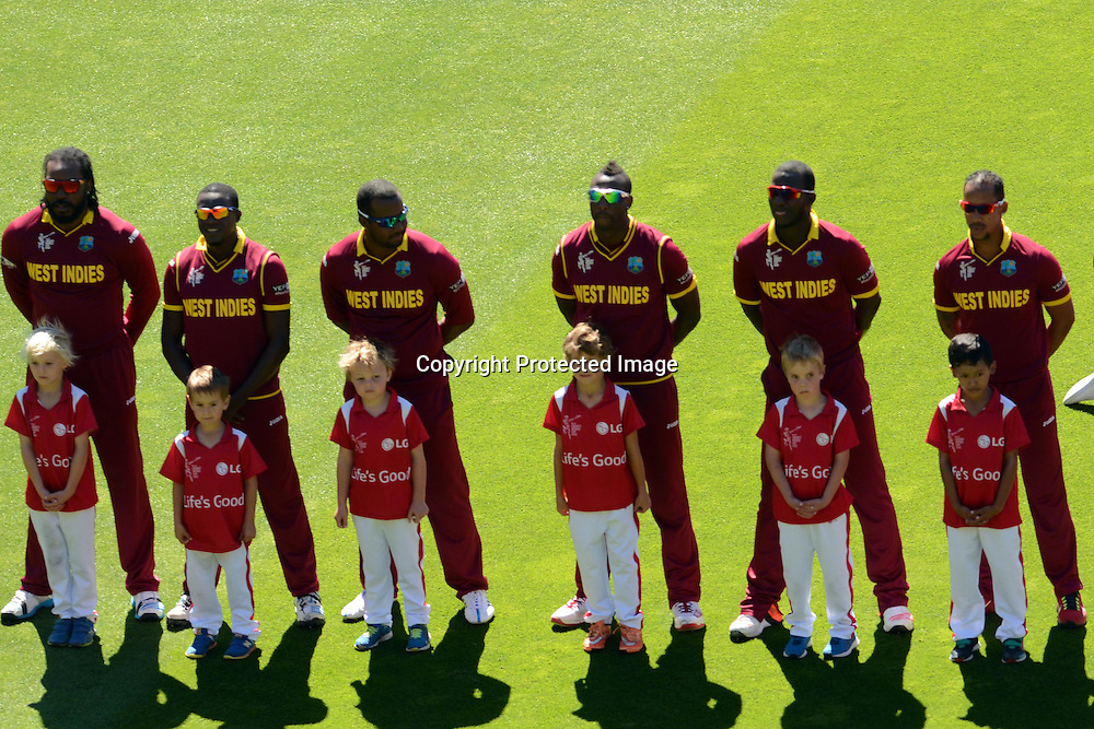 West Indies players line up for their national anthem during the ICC Cricket World Cup Quaterfinal match between New Zealand and West Indies at Westpac Stadium in Wellington, New Zealand. Saturday 21  March 2015. Copyright Photo: Raghavan Venugopal / www.photosport.co.nz