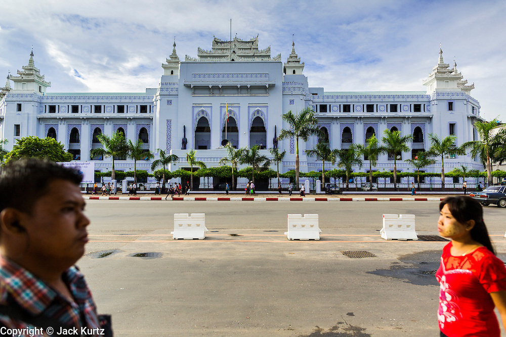 07 JUNE 2014 - YANGON, MYANMAR: Yangon City Hall is a sprawling colonial era building in central Yangon and considered one of the best preserved colonial buildings. Yangon has the highest concentration of colonial style buildings still standing in Asia. Efforts are being made to preserve the buildings but many are in poor condition and not salvageable.    PHOTO BY JACK KURTZ