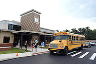 WARMINSTER, PA - SEPTEMBER 3: Students arrive for the first day of school September 3, 2013 at the new McDonald Elementary School in Warminster, Pennsylvania. (Photo by William Thomas Cain/Freelance)
