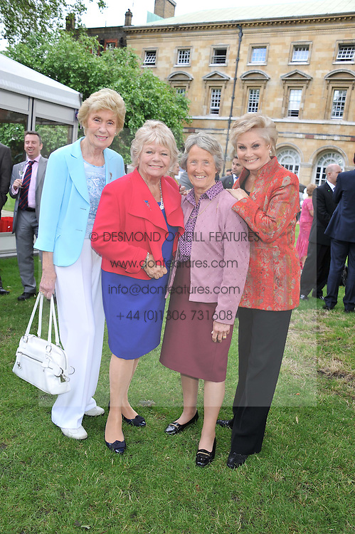 Left to right, JOAN MORECAMBE, JUDITH CHALMERS, BARONESS HEYHOE FLINT and ANGELA RIPPON at The Lady Taverners 25th Anniversary Westminster Abbey Garden Party held in The College Gardens, Westminster Abbey, London o 11th July 2012.