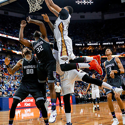 Mar 31, 2017; New Orleans, LA, USA; New Orleans Pelicans forward Anthony Davis (23) dunks over Sacramento Kings guard Tyreke Evans (32) during the second half of a game at the Smoothie King Center. The Pelicans defeated the Kings 117-89. Mandatory Credit: Derick E. Hingle-USA TODAY Sports