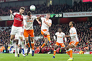 Arsenal defender Shkodran Mustafi (20) and Blackpool defender Ben Heneghan (6) battle for the ball during the EFL Cup 4th round match between Arsenal and Blackpool at the Emirates Stadium, London, England on 31 October 2018.