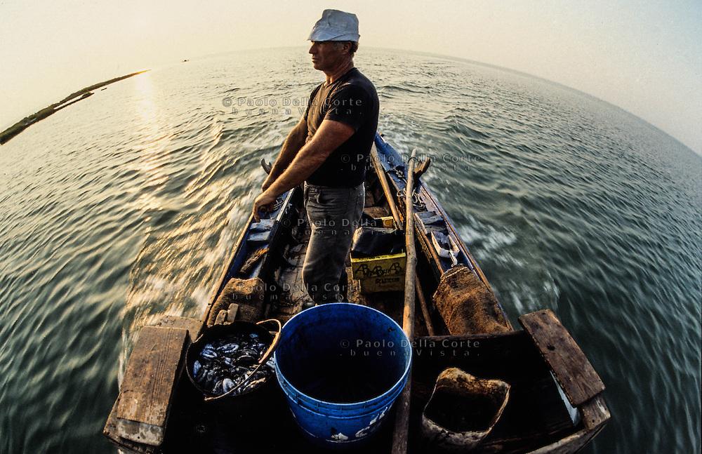 Venice- Moeche fisherman in lagoon.