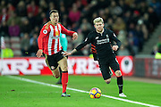 Liverpool defender Alberto Moreno (#18) takes on Sunderland defender Javi Manquillo (#21) during the Premier League match between Sunderland and Liverpool at the Stadium Of Light, Sunderland, England on 2 January 2017. Photo by Craig Doyle.