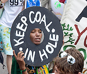A Global Day of Action protester marches along Durban streets, 3 Dec 2011