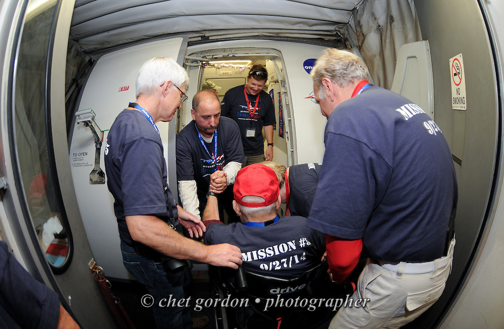 WWII Veterans and their escorts depart Reagan National Airport in Arlington, VA during their Hudson Valley Honor Flight to Washington, DC on Saturday, September 27, 2014. Nearly one hundred WWII Veterans from the Hudson Valley region of New York toured the WWII Memorial in Washington, DC and Arlington National Cemetery in Arlington, VA.  © www.chetgordon.com