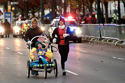 Participants in the wheelchair and hand bike competition are sent as the sun rises over the start location of the 2016 Philadelphia Marathon, on Benjamin Franklin Parkway, on Nov. 21, 2016.<br /> <br /> With the city of Philadelphia taking over organization the course, as well as start and finish locations are slightly different from past years. The winners for 2016 are, in the Mens race, Kimutai Cheruiyot in 2:15:53, and Taylor Ward in the Womens race in 2:36:25