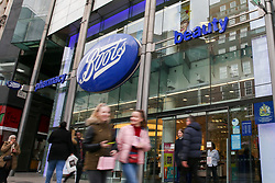 © Licensed to London News Pictures. 03/04/2019. London, UK. Shoppers walk past Boots store on Oxford Street, London. Boots could be forced to close its stores and make redundancies of UK staff after its parent US company, Walgreens Boots Alliance issues a profit warning. Boots employs about 60,000 staff and has 2,500 UK stores. Shares in Walgreens Boots Alliance Inc fell by 13 percent on Tuesday, 2 April 2019. The drop in shares wiped off almost $8 billion from the company's market capitalisation. Photo credit: Dinendra Haria/LNP