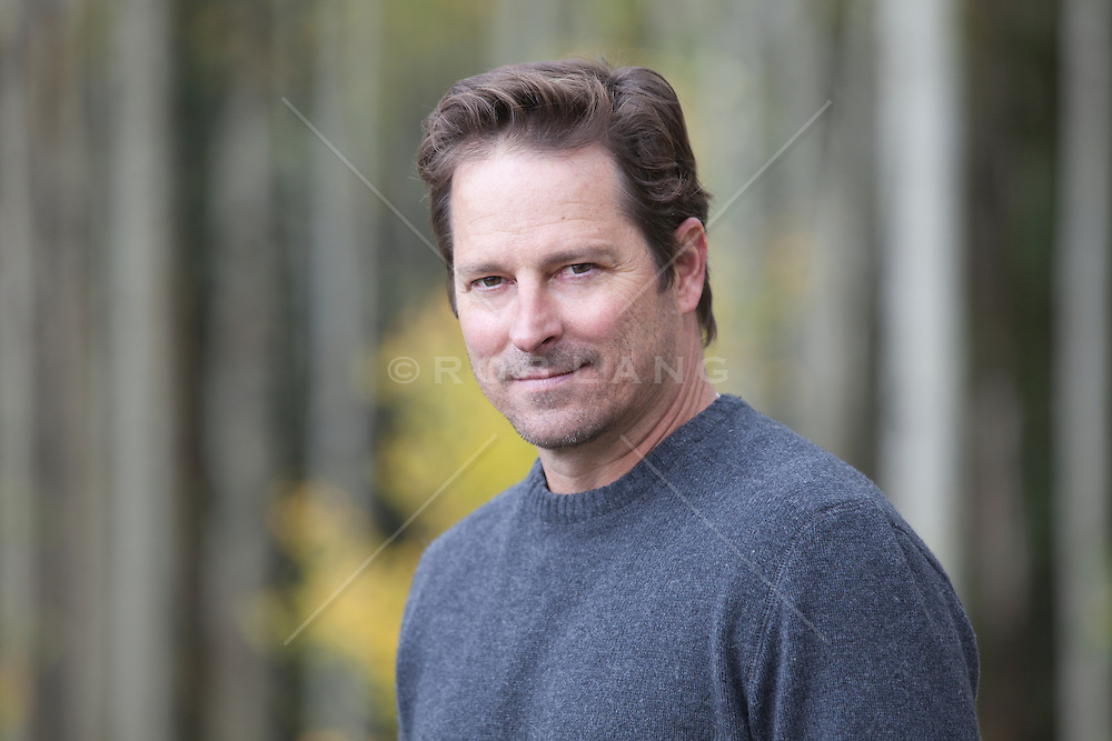 portrait of a handsome middle aged man outdoors