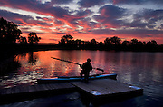 Harry Lahood, 76, readies his 16-foot scull at Detweiler Marina for a predawn paddle on the Illinois River Tuesday. Lahood, a member of Illinois River Oarsmen, took up the sport in 1998  as exercise to combat some health concerns and has since rowed almost daily. Lahood rows a 3-mile routine that takes him to downtown Peoria and back.
