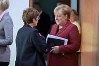 09 OCT 2019, BERLIN/GERMANY:<br /> Annegret Kramp-Karrenbauer (L), CDU, Bundesverteidigungsministerin, und Angela Merkel (R), CDU, Bundeskanzlerin, im Gespraech, vor Beginn der Kabinettsitzung, Bundeskanzöeramt<br /> IMAGE: 20191009-01-031<br /> KEYWORDS: Sitzung, Kabinett, Gespräch