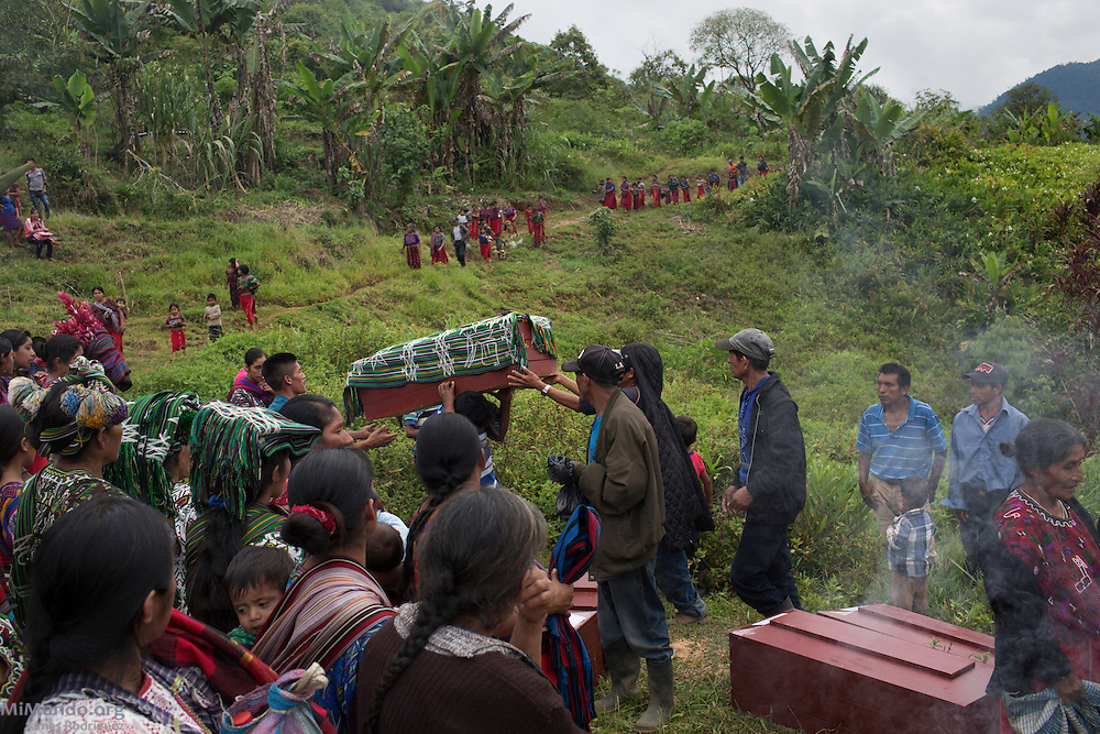 Friends and family prepare for a mass burial of twenty-six identified war victims killed either in 1982 or 1985 who were exhumed from mass graves by members of the Forensic Anthropology Foundation of Guatemala (FAFG) in 2006 and returned for a proper burial nearly a decade later. The village of Xecoyeu is a community founded in the early 1980s by Ixil Mayans displaced by the violence in their communities due to State repression that included dozens of massacres of entire villages as a way to demoralize leftist guerrillas operating in the region. Xecoyeu, Chajul, Quiché, Guatemala. October 7, 2016.