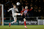 Andy Cannon of Portsmouth  and Conor Coventry of Lincoln City contest a loose ball during the EFL Sky Bet League 1 match between Lincoln City and Portsmouth at Sincil Bank, Lincoln, United Kingdom on 28 January 2020.