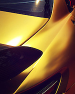 A gold wrapped Mercedes shines in the Carmel sunlight during Monterey Car Week