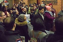 """St Pancras, London, January 16th 2016. Dozens of protesters hold an """"emergency demonstration and die-in"""" as France prepares to bulldoze the Jungle Camp at Calais. PICTURED: The protesters attempt to enter the St Pancras Eurostar terminal via the underground station. ///FOR LICENCING CONTACT: paul@pauldaveycreative.co.uk TEL:+44 (0) 7966 016 296 or +44 (0) 20 8969 6875. ©2016 Paul R Davey. All rights reserved."""