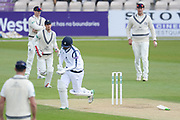 Rilee Rossouw of Hampshire suffers a blow to his injured left hand during the Specsavers County Champ Div 1 match between Hampshire County Cricket Club and Middlesex County Cricket Club at the Ageas Bowl, Southampton, United Kingdom on 16 April 2017. Photo by David Vokes.