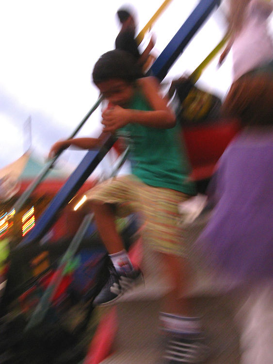 A boy leaps for joy during the annual Feria, Granada, Nicaragua, 2008.
