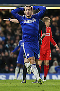 Eden Hazard of Chelsea holds his hands on his head after missing a chance during the Capital One Cup Semi Final 2nd Leg match between Chelsea and Liverpool at Stamford Bridge, London, England on 27 January 2015. Photo by David Horn.
