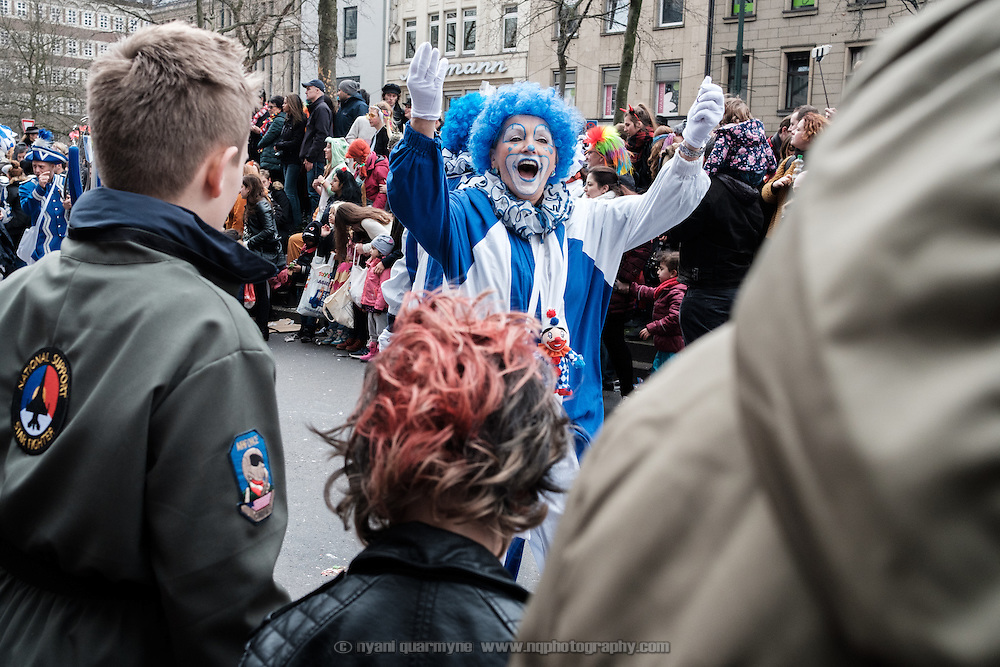A woman dressed as a clown during the traditional Karneval parade in Düsseldorf, Germany on 27 February 2017.