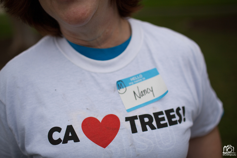 "Volunteers received t-shirts that said ""CA Loves Trees!"" during a tree planting event at Murphy Park in Milpitas, California, on February 15, 2014. Volunteers and city officials planted 50 trees at both Murphy Park and Cardoza Park. (Stan Olszewski/SOSKIphoto)"