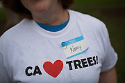 """Volunteers received t-shirts that said """"CA Loves Trees!"""" during a tree planting event at Murphy Park in Milpitas, California, on February 15, 2014. Volunteers and city officials planted 50 trees at both Murphy Park and Cardoza Park. (Stan Olszewski/SOSKIphoto)"""